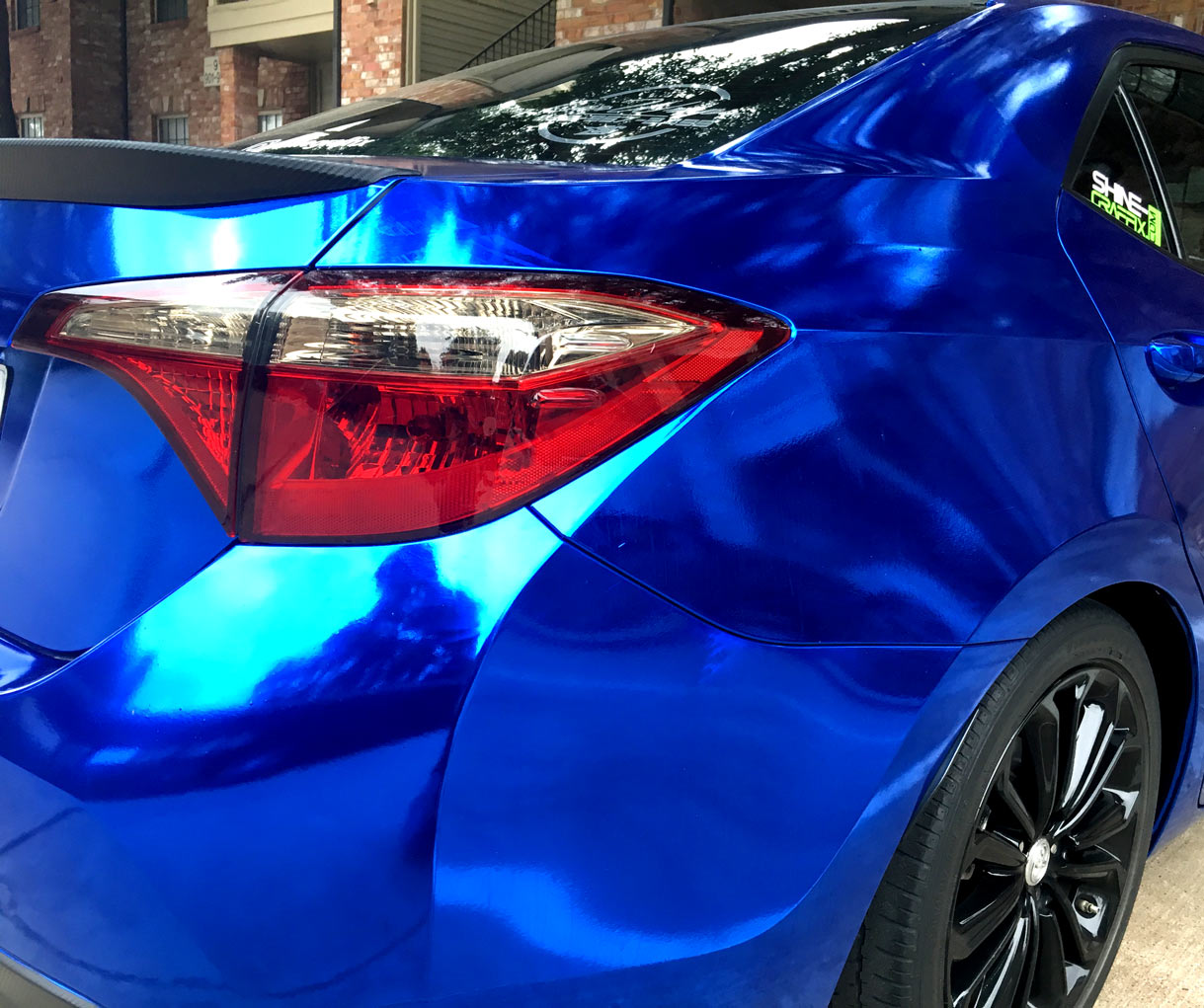 Toyota Corolla taillight precut tint smoked side closeup